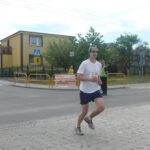biegacz ulica asfalt kostka